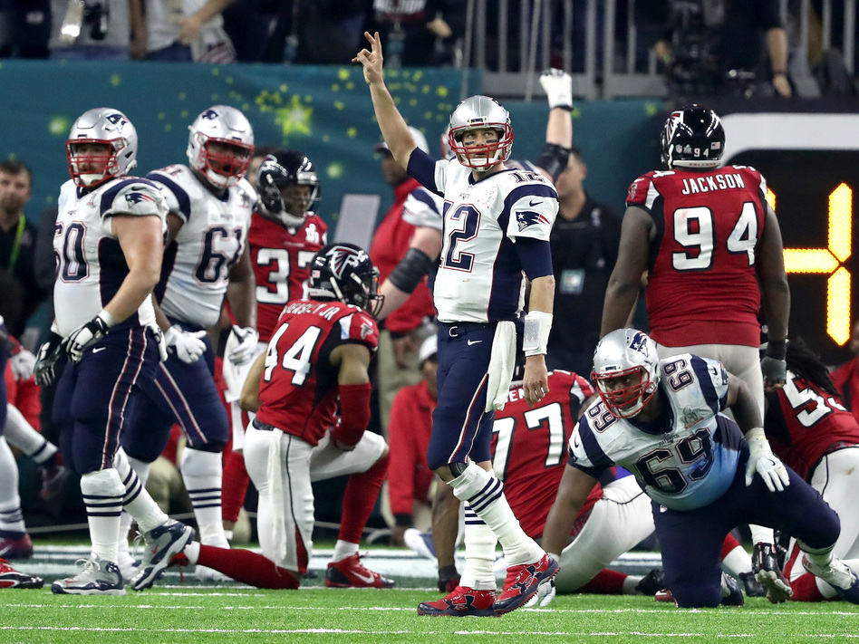Tom Brady of the New England Patriots calls for a two-point try in the fourth quarter of the Super Bowl. The Patriots converted that attempt to send the game into overtime. (Elsa/Getty Images)