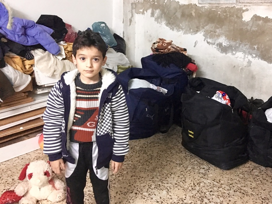 Six-year-old Yazan wants to be a policeman. His parents say he started stuttering after being frightened by the sound of jets in Syria and he still doesn't talk much. (Jane Arraf/NPR)