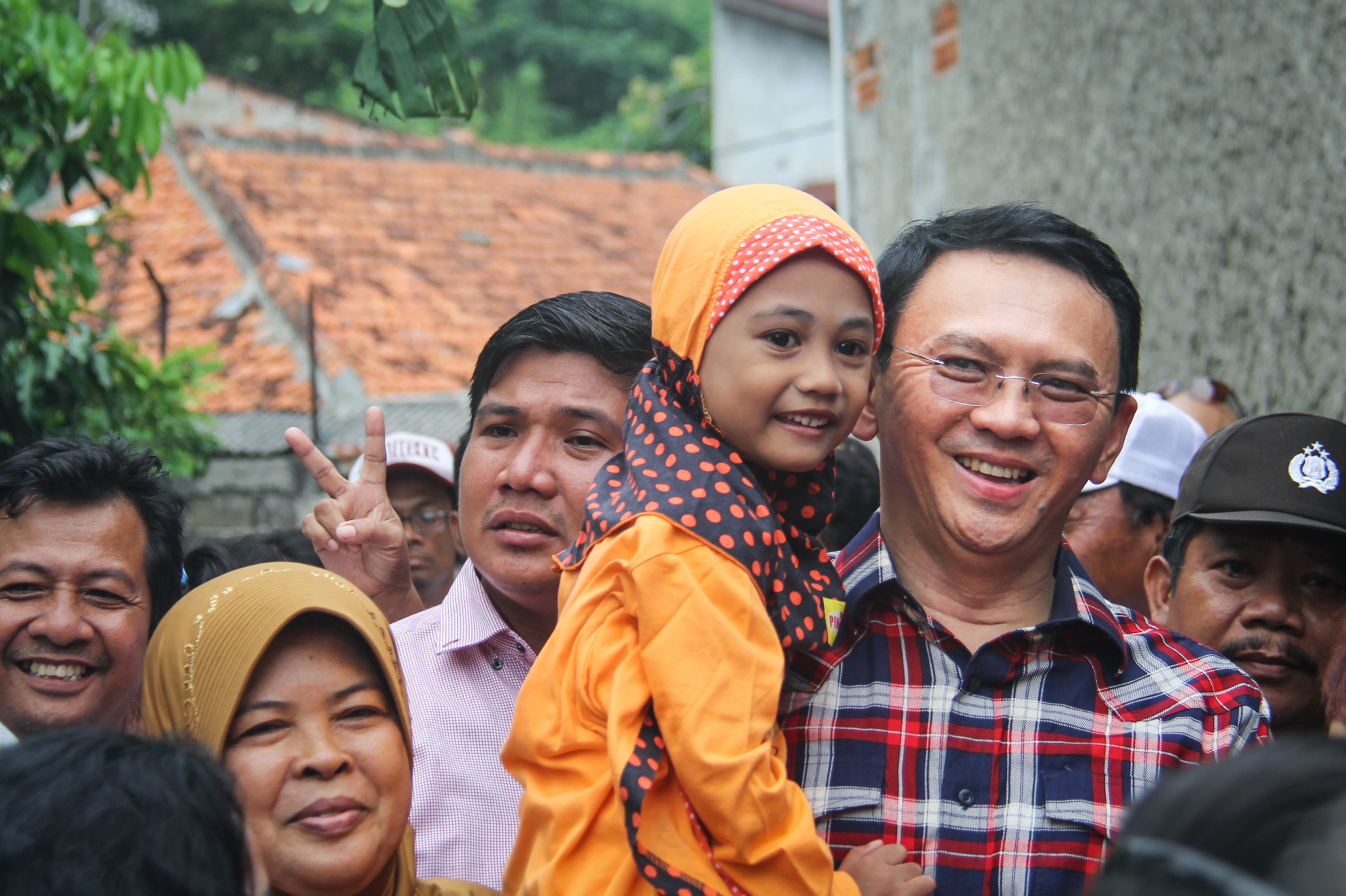 Residents and reporters follow Basuki Tjahaja Purnama, the first Christian,  ethnic Chinese governor of Jakarta, as he campaigns for election in an East  ...