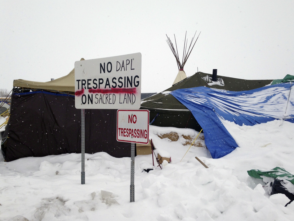 Protesters have stayed near the Dakota Access Pipeline site during the winter. (James MacPherson/AP)
