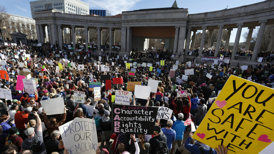 Thousands gather at Denver's City Center Park on Saturday for a rally in support of the Muslim community and to protest President Trump's executive order to temporarily ban some refugees from seven mostly Muslim countries. (Brennan Linsley/AP)