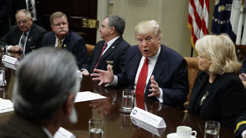 President Trump speaks during a meeting with county sheriffs at the White House on Tuesday. (Evan Vucci/AP)