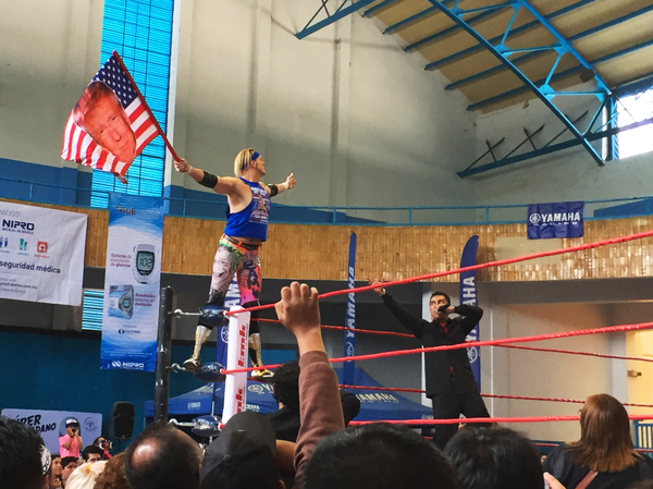 Sam Polinsky, known by his lucha libre wrestling moniker Sam Adonis, enters the ring waving his Trump American flag and riling up the audience in Mexico City.