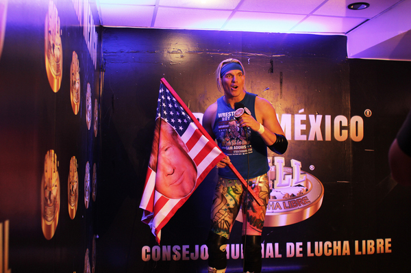 """""""Go America! Go Trump!"""" lucha libre wrestler Sam Adonis yells in a promotional video, beamed out to the crowd of 10,000 waiting to see him fight."""