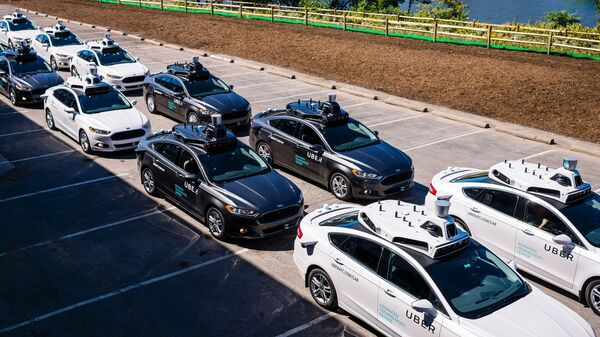 Pilot models of self-driving cars for Uber are displayed in Pittsburgh. Autonomous vehicles are expected to cut traffic jams, but not before enough human drivers are off the road.