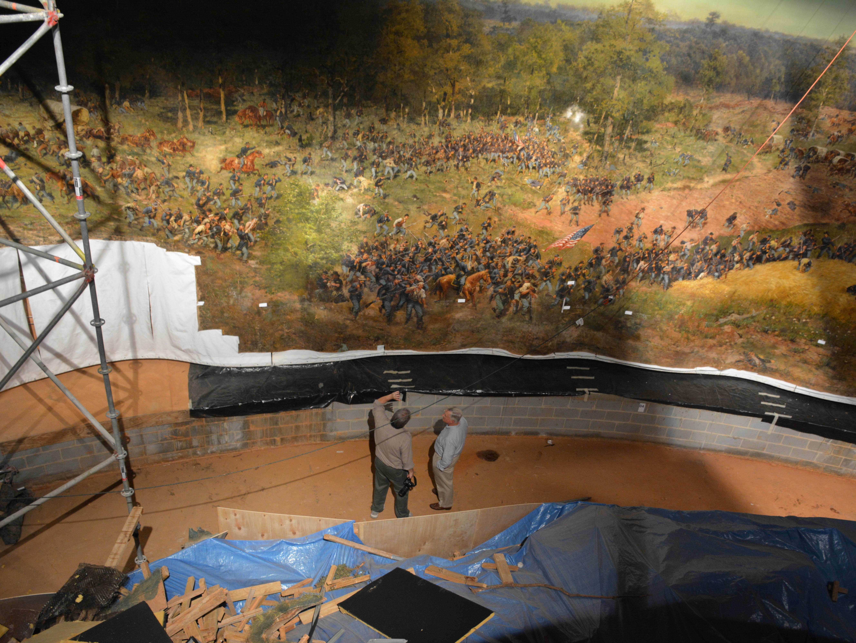 Atlanta rolls up moves an old oil painting all 374 feet for Atlanta mural artist