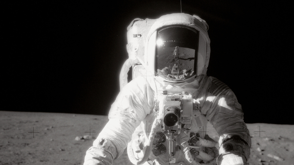 """Astronaut Alan Bean was photographed by Charles """"Pete"""" Conrad Jr., who is reflected in Bean"""