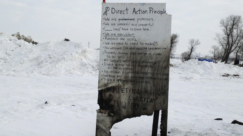 A sign is seen at an encampment set up near Cannon Ball, N.D., Wednesday, where opponents are protesting the construction of the Dakota Access pipeline. (James MacPherson/AP)