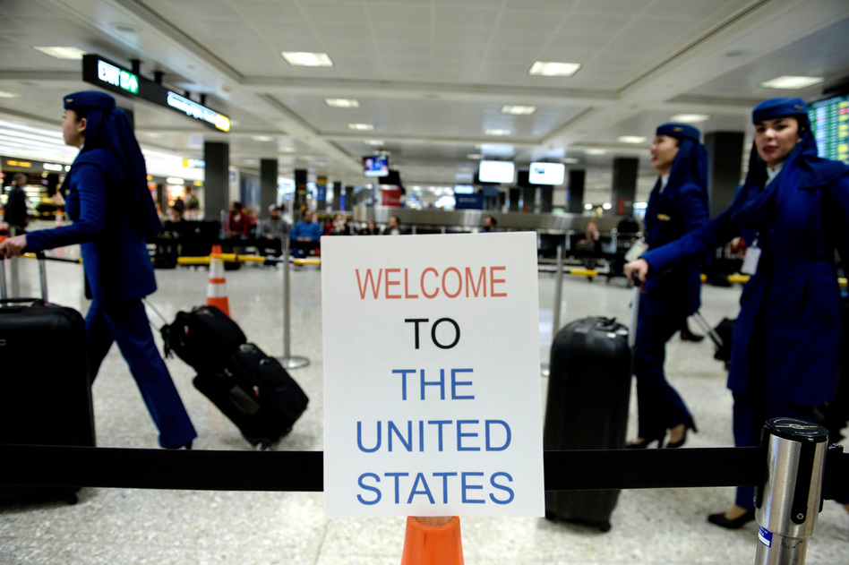 A sign at Washington Dulles International Airport welcomes travelers. A three-judge panel decided not to reinstate President Trump's travel ban barring travelers from seven majority-Muslim nations. (Brendan Smialowski/AFP/Getty Images)