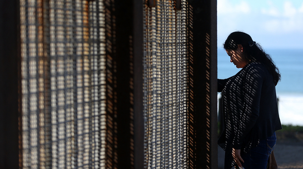 A visitor stands next to the U.S.-Mexico border fence at Friends of Friendship Park on February 4, 2017 in San Ysidro, California.