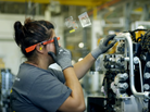 A factory worker in Jackson, Minn., uses Google Glass on the assembly line.