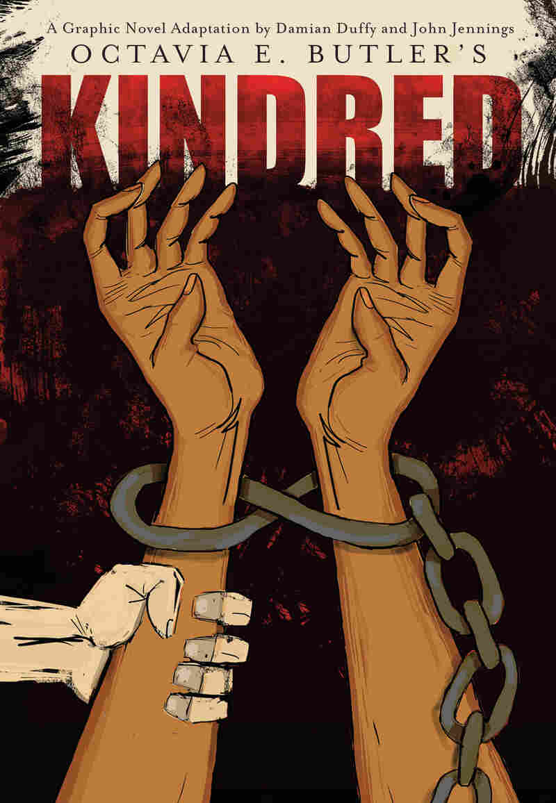 The cover of the graphic novel, which shows two shackled black wrists with a white hand gripping one of the arms.