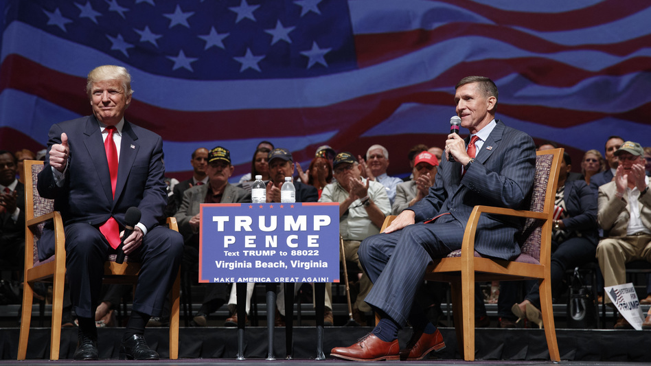 Then-presidential candidate Donald Trump gives a thumbs up as he speaks with retired Lt. Gen. Michael Flynn during a September 2016 town hall in Virginia Beach, Va. (Evan Vucci/AP)
