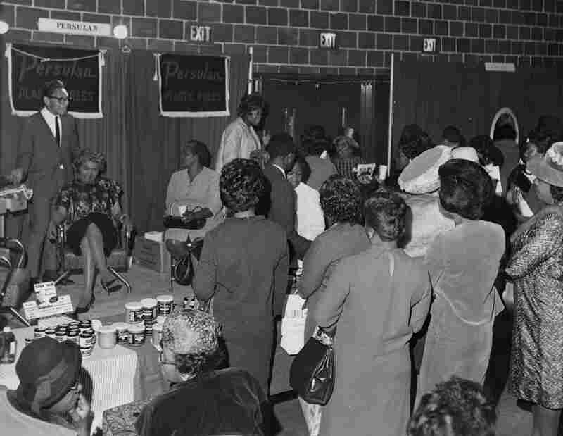 Persulan representatives hosting product demonstrations for hairstylists at the Bronner Beauty Show in 1965.