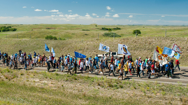 Demonstrators march from an encampment on the banks of the Cannonball River to a nearby construction site for the Dakota Access Pipeline to perform a daily prayer ceremony in September 2016.