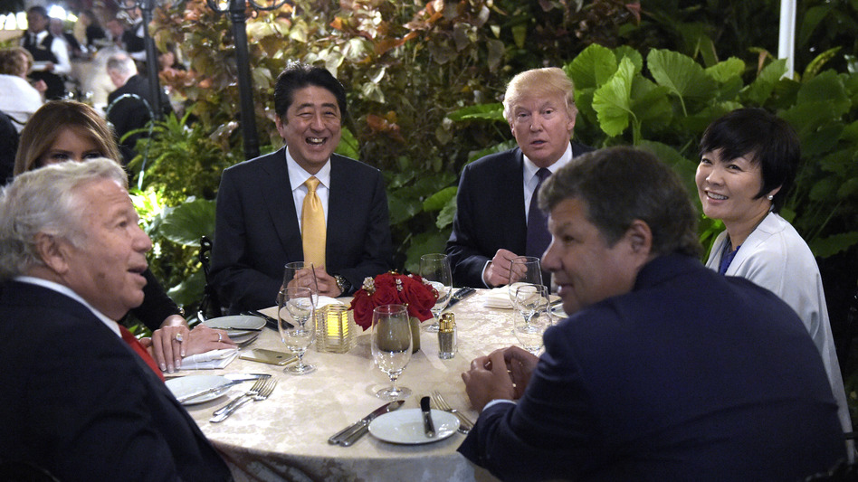 President Trump and first lady Melania Trump (hidden at left) have dinner with Japanese Prime Minister Shinzo Abe and his wife, Akie, at Mar-a-Lago in Palm Beach, Fla., on Feb. 10. Trump said he would personally pay for the visit to his resort . (Susan Walsh/AP)