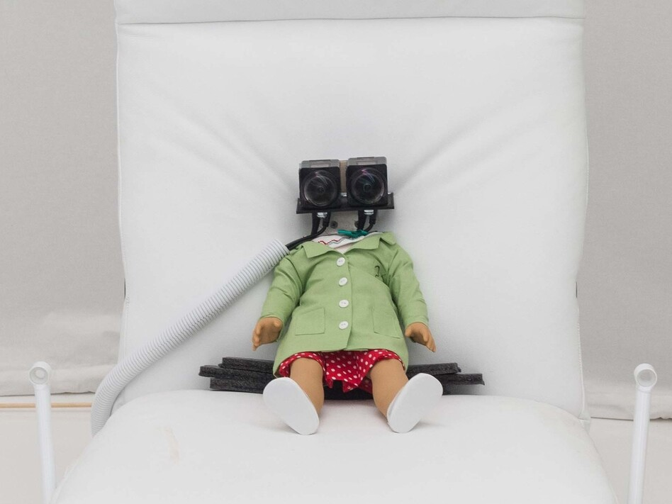 "A virtual reality installation allows visitors to experience a doll's perspective as she's poked and prodded by a lab assistant. <strong><a href=""https://ww2.kqed.org/arts/2016/10/25/david-byrnes-theatrical-thought-experiment-in-silicon-valley/"">Read the full story at KQED.</a></strong>"