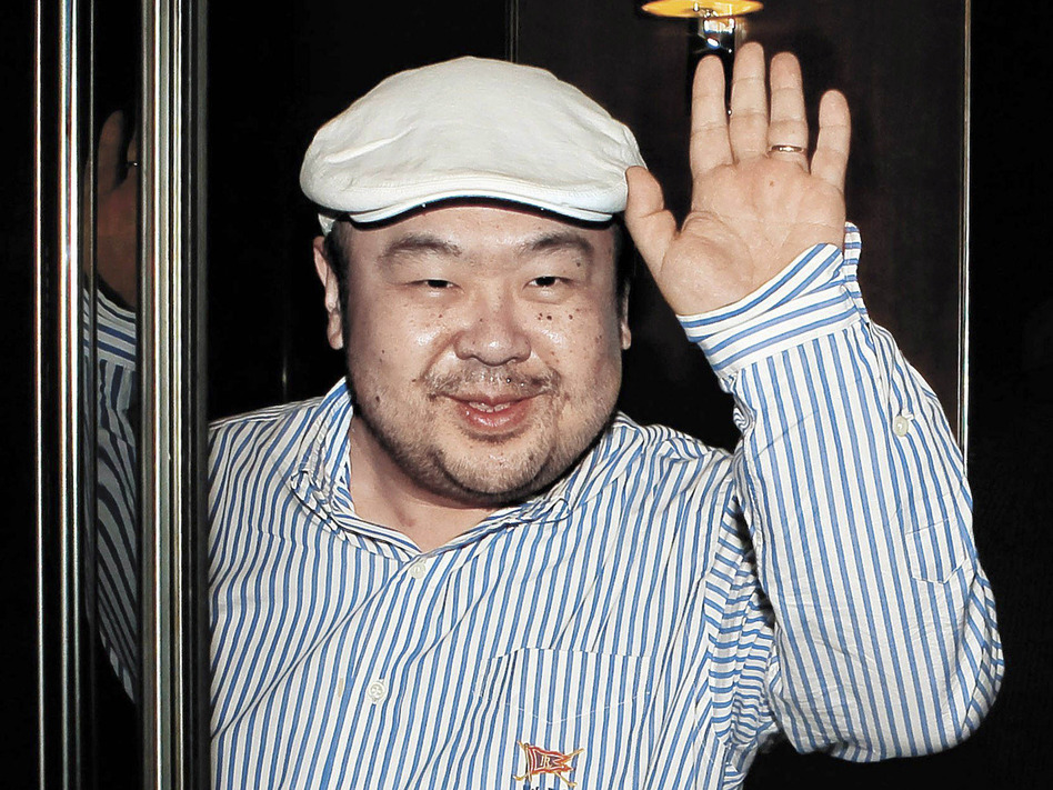 Kim Jong Nam, the half-brother of North Korean leader Kim Jong Un and the eldest son of former leader Kim Jong Il, waves to reporters on the Chinese island of Macau in 2010. (Shin In-seop/AP)