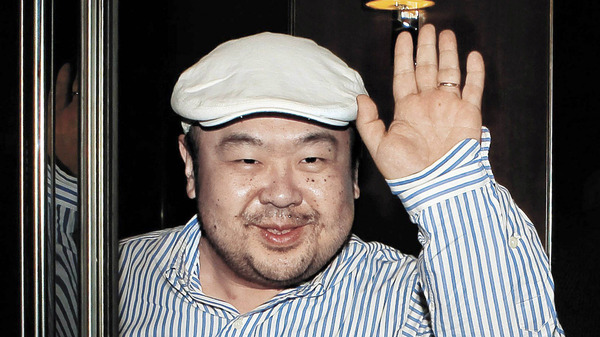 Kim Jong Nam, the half-brother of North Korean leader Kim Jong Un and the eldest son of former leader Kim Jong Il, waves to reporters on the Chinese island of Macau in 2010.