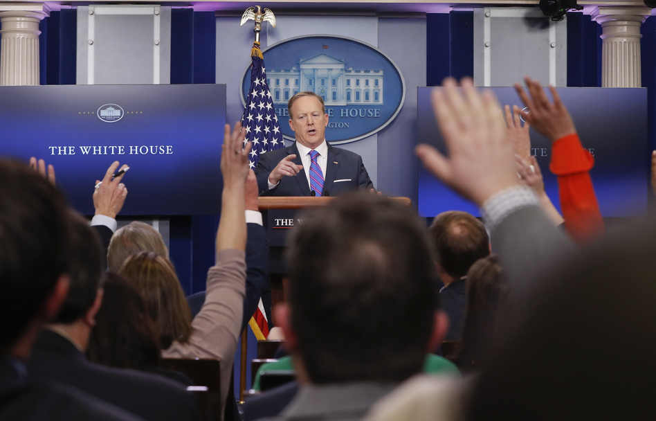White House Press secretary Sean Spicer takes questions from the media on Tuesday. He said it was President Trump's decision to have national security adviser Michael Flynn resign. (Pablo Martinez Monsivais/AP)