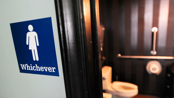 A gender neutral sign is posted outside a bathroom on May 11, 2016 in Durham, North Carolina.