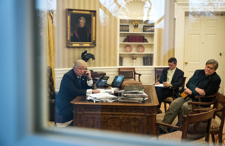 President Trump speaks on the phone in the Oval Office with now-former national security adviser Michael Flynn (center) and White House chief strategist Steve Bannon on Jan. 28. (Drew Angerer/Getty Images)