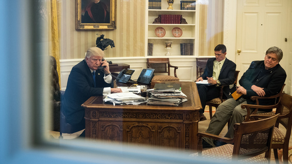 President Trump speaks on the phone in the Oval Office with now-former national security adviser Michael Flynn (center) and White House chief strategist Steve Bannon on Jan. 28.