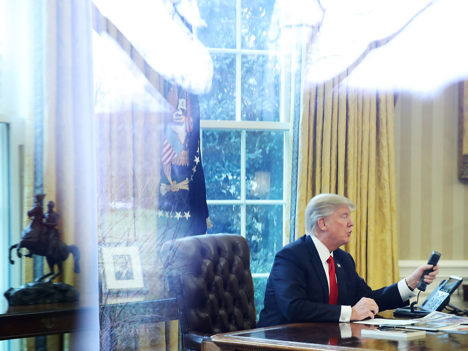 President Trump calls the king of Saudi Arabia, Salman bin Abd al-Aziz Al Saud, in the Oval Office of the White House on Jan. 29. (Mark Wilson/Getty Images)