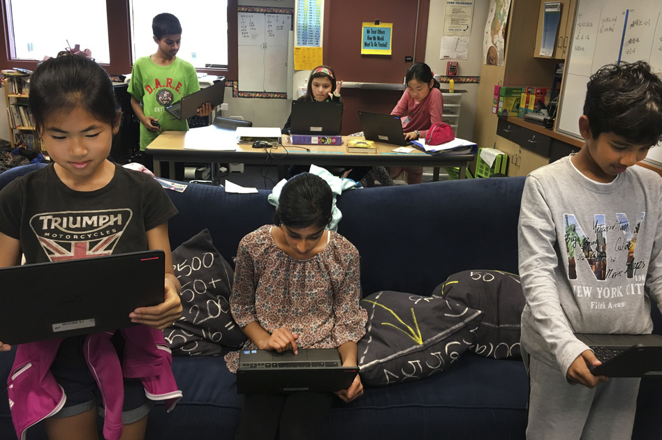 """Students in Scott Bedley's fifth-grade class at Plaza Vista School in Irvine, Calif., play a version of """"Simon Says"""" with fake news. (Courtesy of Scott Bedley)"""