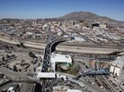 A border in the Rio Grande culvert divides the Mexican city of Juárez (bottom) and the U.S. city of El Paso, Texas, shown here in 2010.