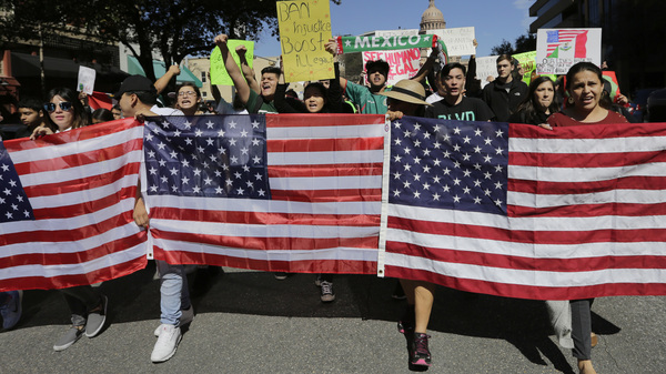 Demonstrators march through downtown Austin, Texas, on Thursday. Protesters are targeting recent immigration raids around the country.