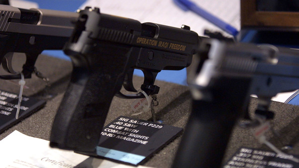 A handgun on display at the National Rifle Association