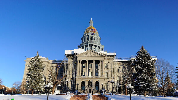 "The state Capitol in Denver in December. The Grand Junction Sentinel has threatened to sue state Sen. Ray Scott after the lawmaker accused the paper of spreading ""fake news."""