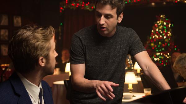 La La Land composer Justin Hurwitz on set with star Ryan Gosling.