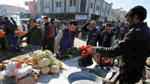 Life Inches Back To Normal In East Mosul, But Worries Remain