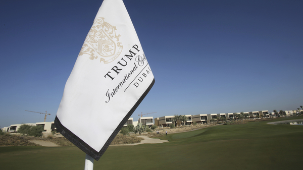 A flag flies on a green lined with villas at the Trump International Golf Club, in Dubai, United Arab Emirates. The 18-hole golf course in Dubai bearing Donald Trump
