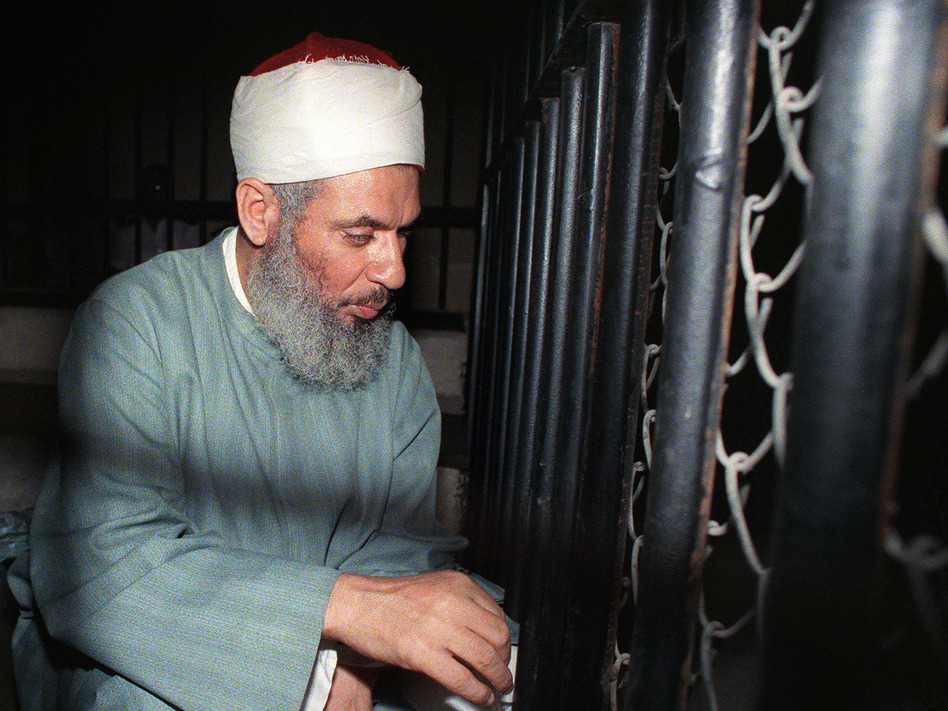 Blind Sheikh Omar Abdel Rahman sits and prays inside an iron cage at the opening of a court session in Cairo in 1989. (Mike Nelson/AFP/Getty Images)