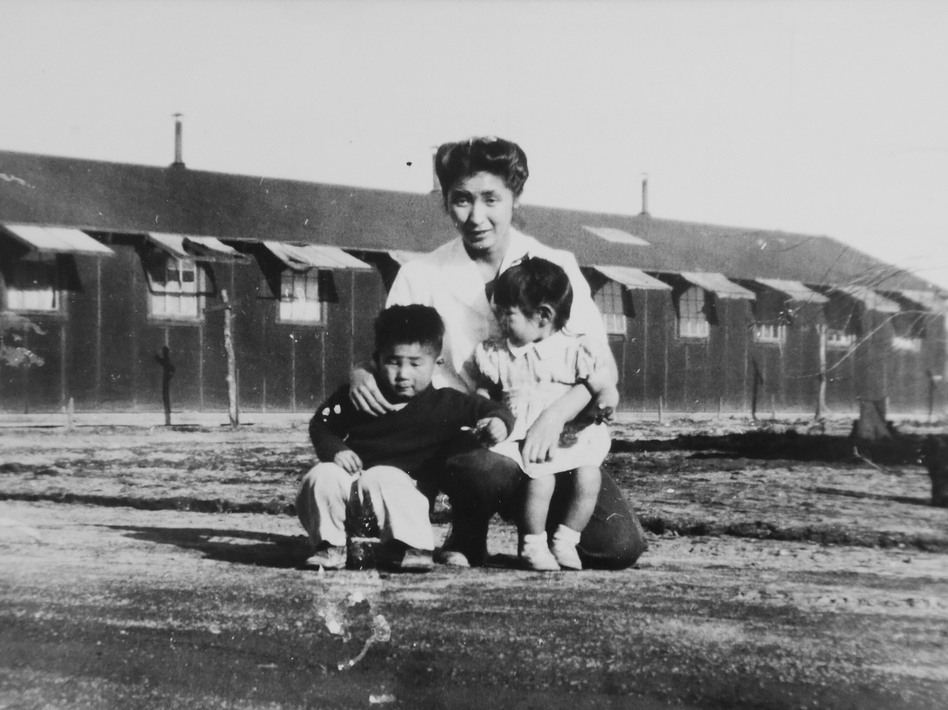This 1945 photo provided by the family shows Shizuko Ina, with her son Kiyoshi (left) and daughter Satsuki in an internment camp in Tule Lake, Calif. This photograph was taken by a family friend who was a soldier at the time, since cameras were considered contraband at the camp. Satsuki was born at the camp. (Courtesy of the Ina family/AP)