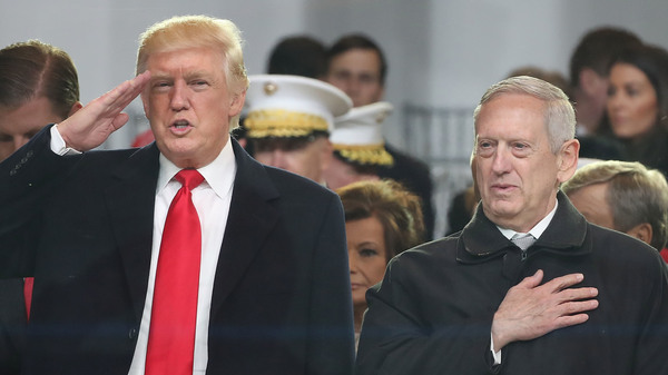 President Donald Trump stands with Secretary of Defense Gen. James Mattis as a parade passes reviewing stand in front of the White House last month.