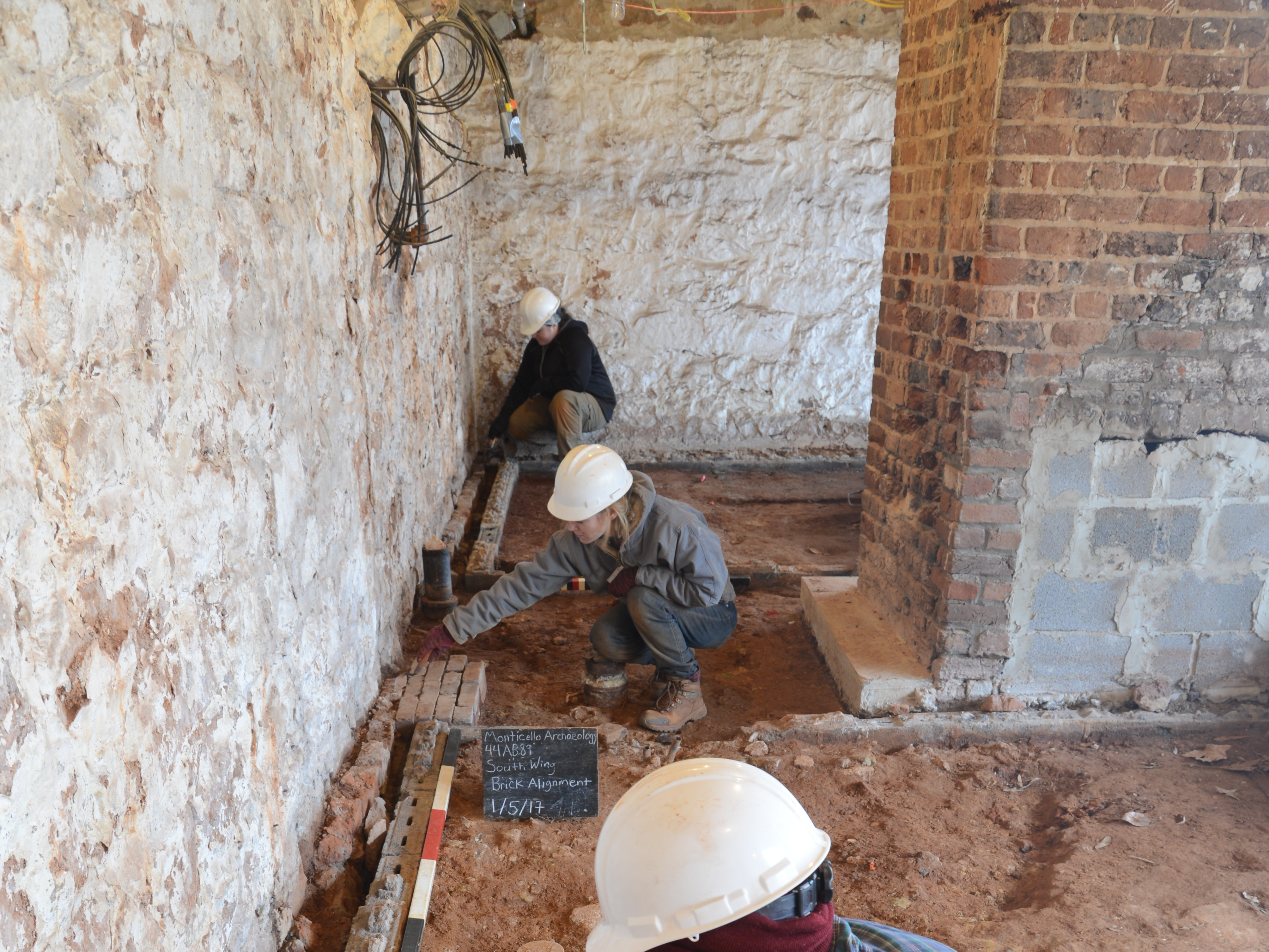 Archaeologists uncover the original brick floor of what is believed to be Sally Hemings' living quarters at Monticello.     ©Thomas Jefferson Foundation at Monticello