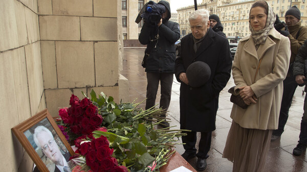 People pay respects to the late Russian U.N. ambassador Vitaly Churkin outside Moscow