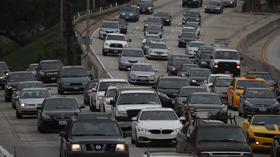 Cars on Highway 101 in Los Angeles on Tuesday. Around the nation, Americans drove a record number of miles last year. (Justin Sullivan/Getty Images)