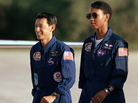 Mamoru Mohri and Mae Jemison walk together after arriving with the rest of the STS-47 crew on Sept. 9, 1992, at Kennedy Space Center in Florida.