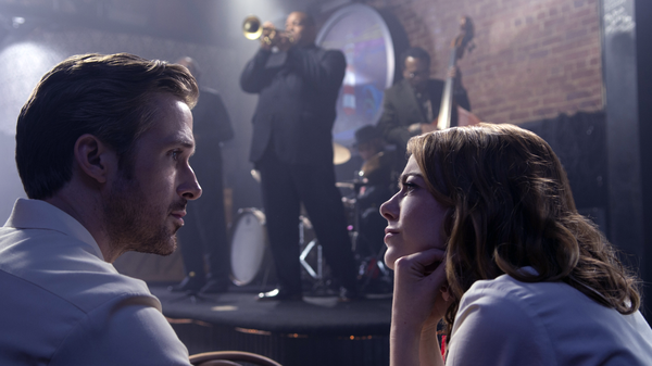 "Ryan Gosling and Emma Stone at a jazz club in the movie ""La La Land""."