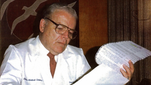 Dr. C. David Molina reviewing medical records in the 1980s. He was a doctor first, then a health insurer.