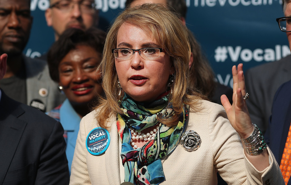 "Former Rep. Gabrielle Giffords says lawmakers should ""have some courage"" and face their constituents at town halls, despite protests. (Spencer Platt/Getty Images)"