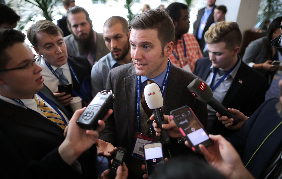 Reporters surround white nationalist Richard Spencer on Thursday at the Conservative Political Action Conference in National Harbor, Md. (Chip Somodevilla/Getty Images)