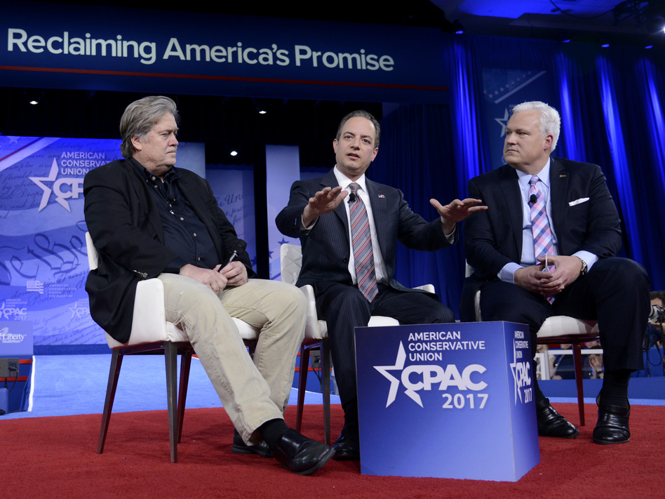 White House Chief of Staff Reince Priebus (center) speaks onstage at CPAC in National Harbor, Md., with White House adviser Steve Bannon (left) and American Conservative Union Chairman Matt Schlapp on Thursday. (Mike Theiler/AFP/Getty Images)