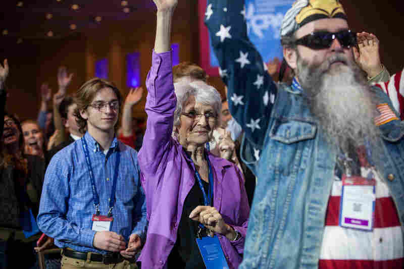 "Attendees cheer during a special taping of ""Hannity"" on the first day of the conference."