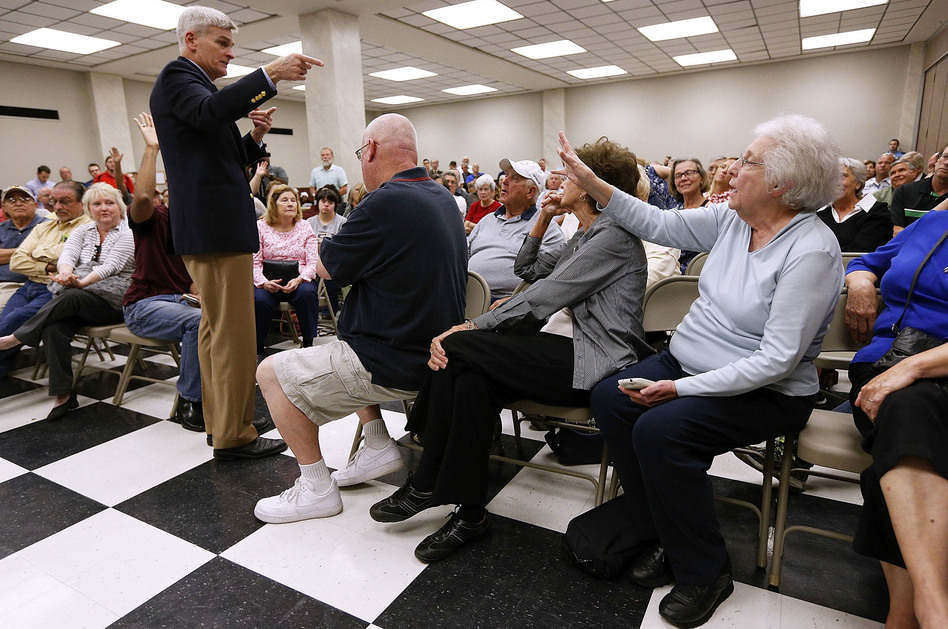 Sen. Bill Cassidy, R-La., responds to constituents concerned about their coverage under the Affordable Care Act. (Jonathan Bachman/Getty Images)